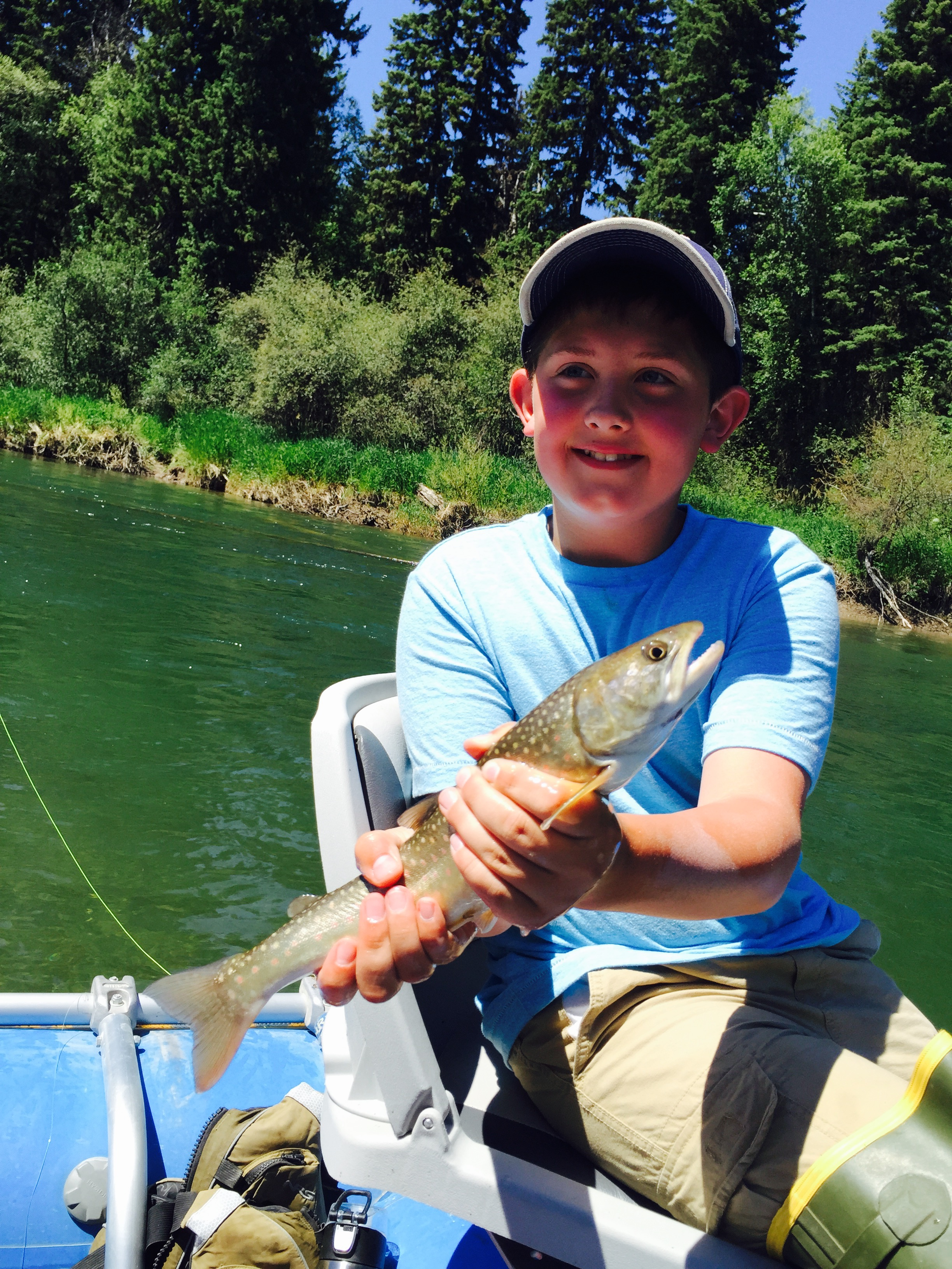 Boy on Fishing Trip - Swan Mountain Outfitters